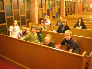 Some of the kids waiting for the worship to begin, having left one shoe at the door.